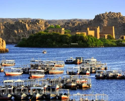 Agilkia Island (or Agilika Island) in Lake Nasser. Philae Temple of Isis seen from the Aswan Low Dam