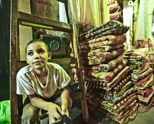 Boy in carpet store, Khan El Khalili Bazaar
