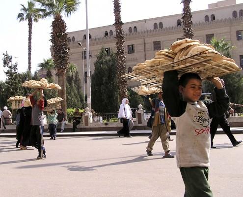 Boy selling bread in the Khan-el-Khalili bazaar