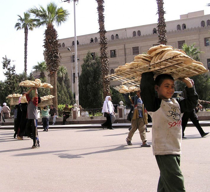 Boy selling bread in the Khan-el-Khalili bazaar