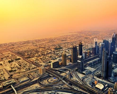 Dubai skyline along Sheikh Zayed Road at sunset