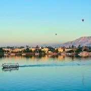 Egypt Vacation Tour Packages - Balloons above Luxor, Egypt at dawn