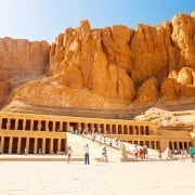 Luxor Egypt Vacation Packages - Tourists at the Mortuary Temple of Queen Hatshepsut which was dedicated to the Sun God Amon-Ra