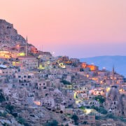 Nevsehir cave city in Cappadocia, Turkey at sunset