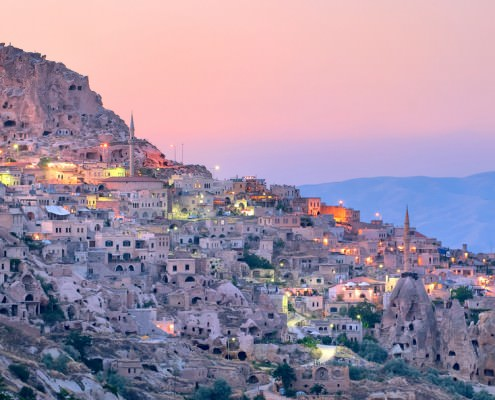 Nevsehir cave city in Cappadocia, Turkey at sunset