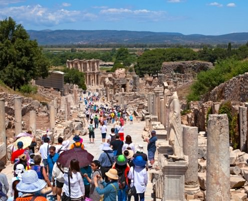 Tourists visiting the Greek-Roman ruins of Ephesus