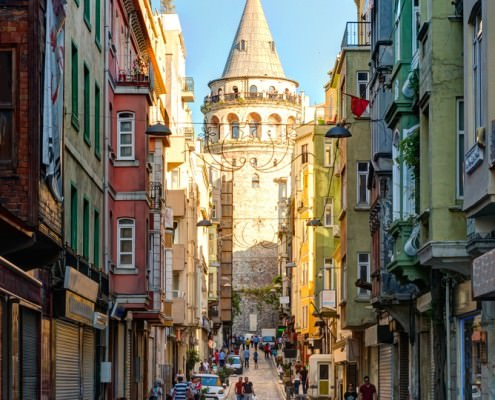View of old narrow street with the Galata Tower
