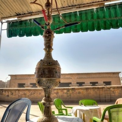 Water pipe in a cafe with view of Khnum Temple
