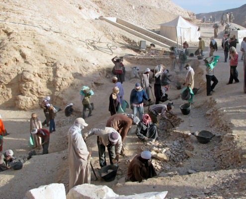 Workers sift through dirt and debris at an archaeological site at the Valley of the Kings