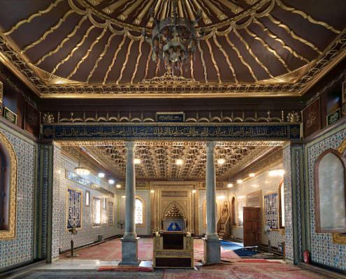 Interior of public mosque of Manial Palace of Prince Mohammed Ali with wooden golden ornate ceilings with design based on old logo of the Ottoman empire, Cairo, Egypt