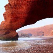 Agadir Attractions - Red archs on Atlantic Ocean coast. Agadir, Morocco