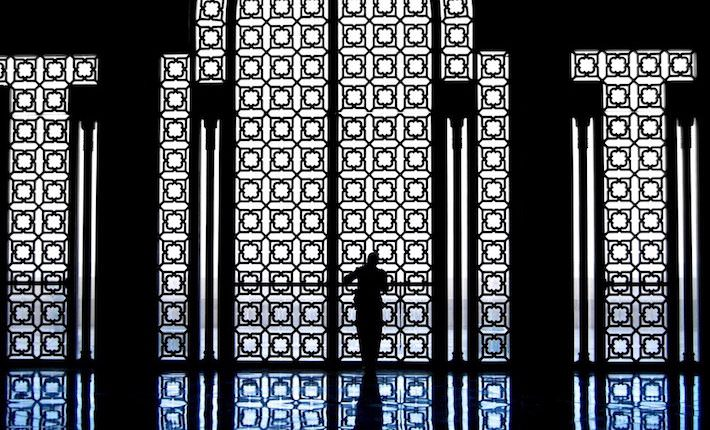 Casablanca Attractions - A woman inside the King Hassan mosque in Casablanca, Morocco