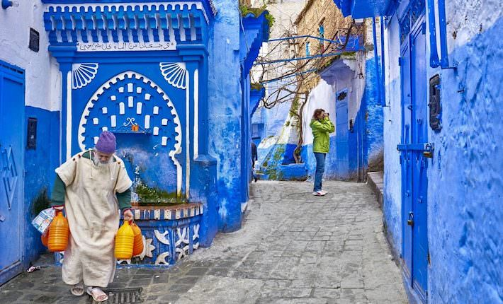 CHEFCHAOUEN, MOROCCO - FEBRUARY 22- Unidentified local man carries water from the well
