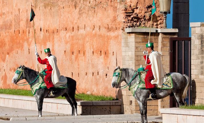 Places to visit in Rabat - Royal guard in front of Hassan Tower and Mausoleum of Mohammed V. Mausoleum contains tombs of late King Hassan II and Prince Abdallah. November 25, 2014 in Rabat, Morocco
