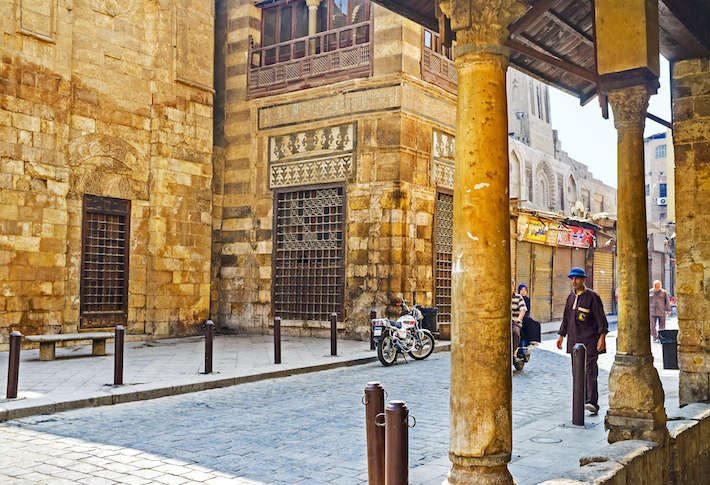 Stone walls of the medieval Qalawun complex on the oldest street in Cairo, Al-Muizz Street