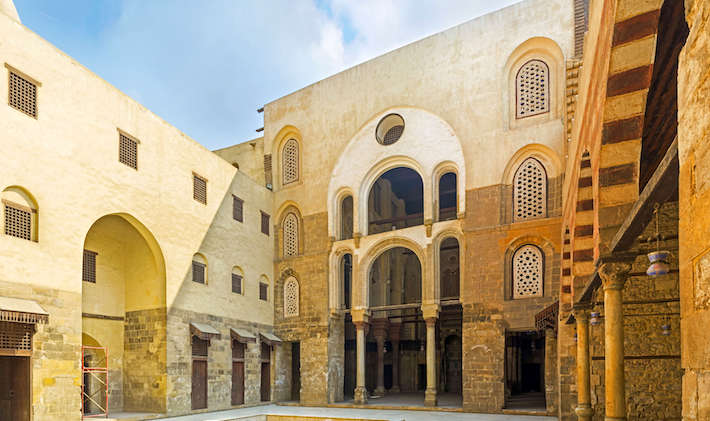 The courtyard Qalawun complex with the view on the arched rebuilt entrance to the medieval mosque