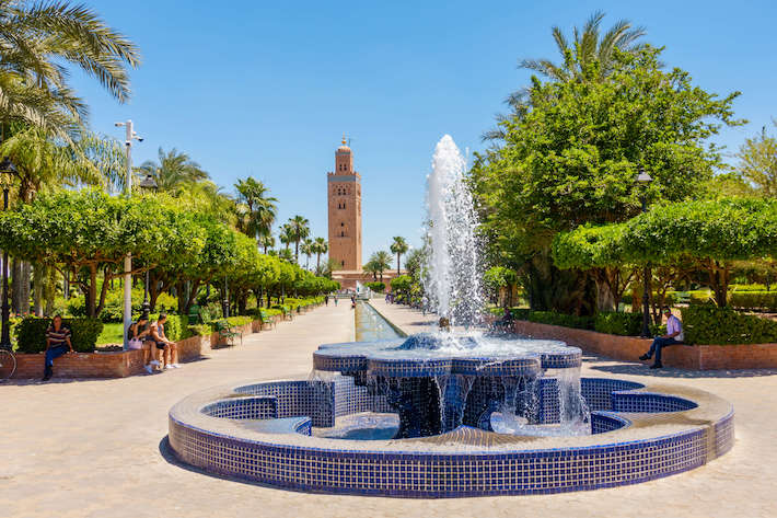 Fountain in the Koutoubia Gardens with view of the Koutoubia Mosque in Marrakech
