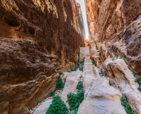 A small passage between the steep rocks at Little Petra in Siq al-Barid, Wadi Musa, Jordan