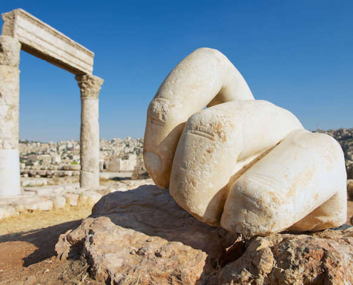 Hand of Hercules at the Citadel in Amman and Amman city in the background