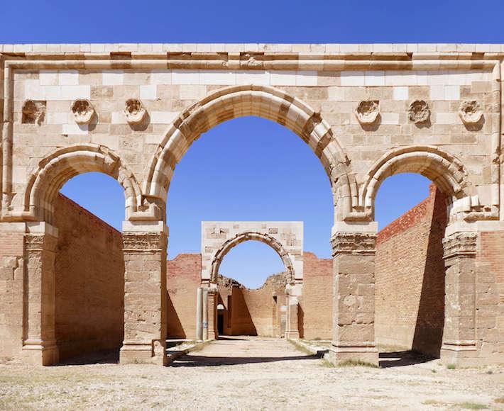 The beautiful ancient Roman arch ruins at Qasr Al-Mshatta Umayyad Palace in Jordan