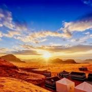 Jordan Tour Packages from Dubai - Scenic view of the Jordanian desert at sunset in Wadi Rum, Jordan