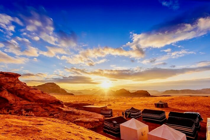 Jordan Tour Packages from Dubai - Scenic view of the Jordanian desert at sunset in Wadi Rum, Jordan